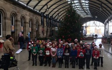 Choir singing in the Central Station